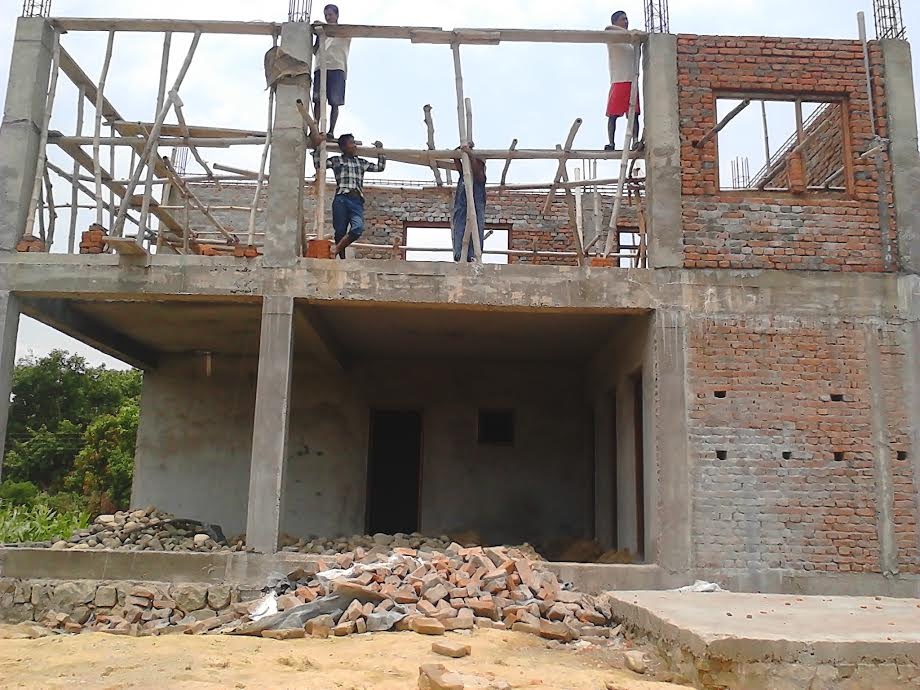Nepalese workmen building Unako House - Courtesy Kevin Edgecombe