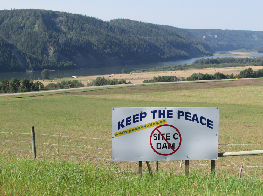 Signs protesting the Site C dam are plentiful along Highway 29 between Fort St. John and Hudson's Hope. Photo credit: Emma Gilchrist, DeSmog Canada, CC BY SA, 2.0.