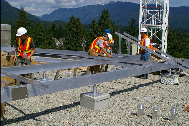 Photo Credit: nstallation begins on the largest photovoltaic (solar electric) installation in the lower mainland. Located at the Lynn Valley Care Centre in North Vancouver, BC. Installation work by Vancouver Renewable Energy ( www.vrec.ca ) By Rob Baxter via Fickr (CC By SA, 2.0 License)