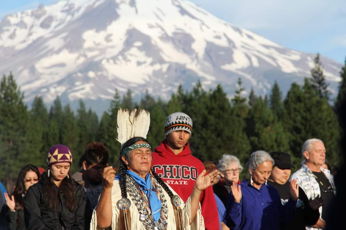 Caleen Sisk Praying in front of Mount Shasta