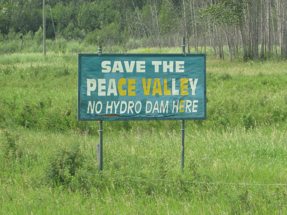 Signs protesting the Site C dam are plentiful along Highway 29 between Fort St. John and Hudson's Hope. Photo credit: Emma Gilchrist, DeSmog Canada.