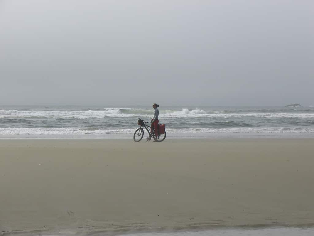 Cycling along the beach, Tofino by djmonkeyboy via Flickr (CC BY SA, 2.0 License)