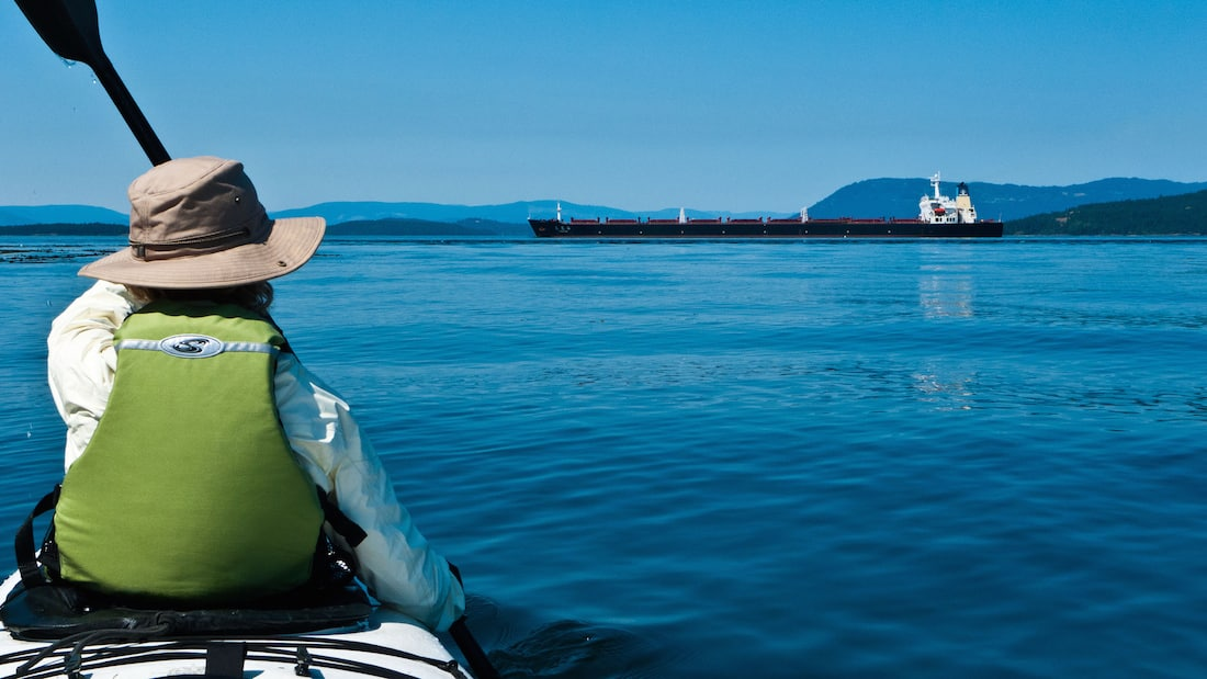 Along the tanker route: Kayaker watching passing tanker by fujitariuji via Flickr (CC BY SA, 2.0 License)