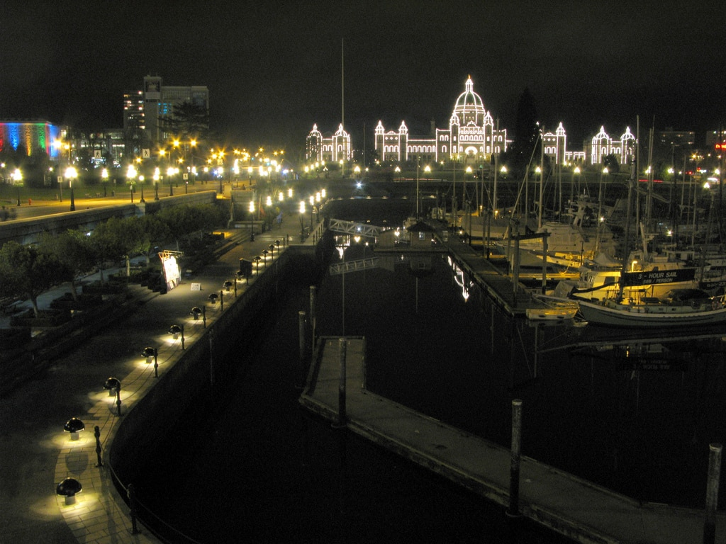 BC Legislature and the Inner Harbour at night by zemistor via Flickr (CC BY SA, 2.0 License)