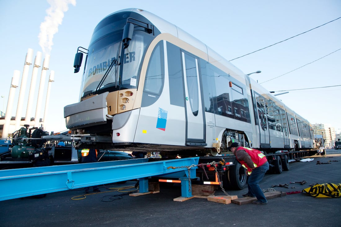 Bombardier FLEXITY Streetcar has finally arrived safely under the Cambie Bridge. A custom built ramp is crucial for its safe transition from transport trailer to tracks at False Creek under Cambie Bridge- Courtesy City of Vancouver