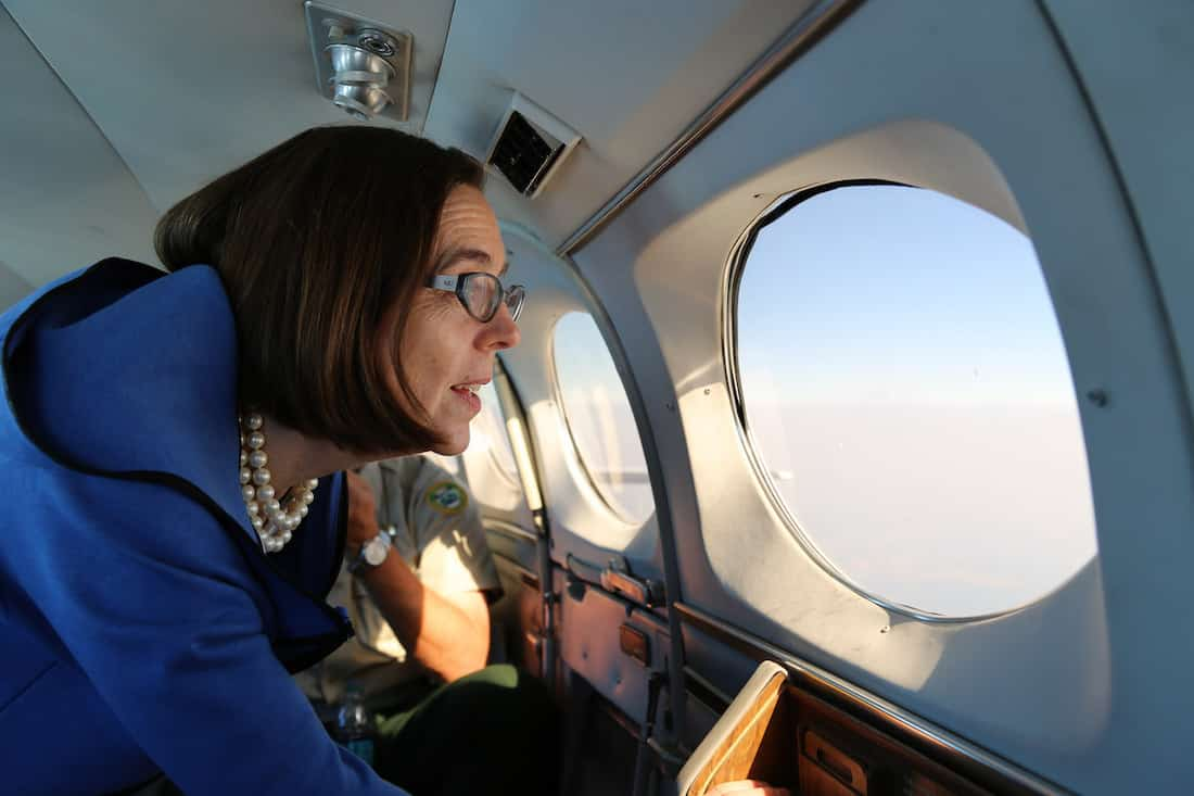 Governor Kate Brown heads to visit Soldiers with Charlie Co., 7-158. Aviation, who are assisting with firefighting efforts near the Canyon Creek area in August 2015. Photo courtesy of Oregon Governor's Office.(CC BY SA, 2.0 License)