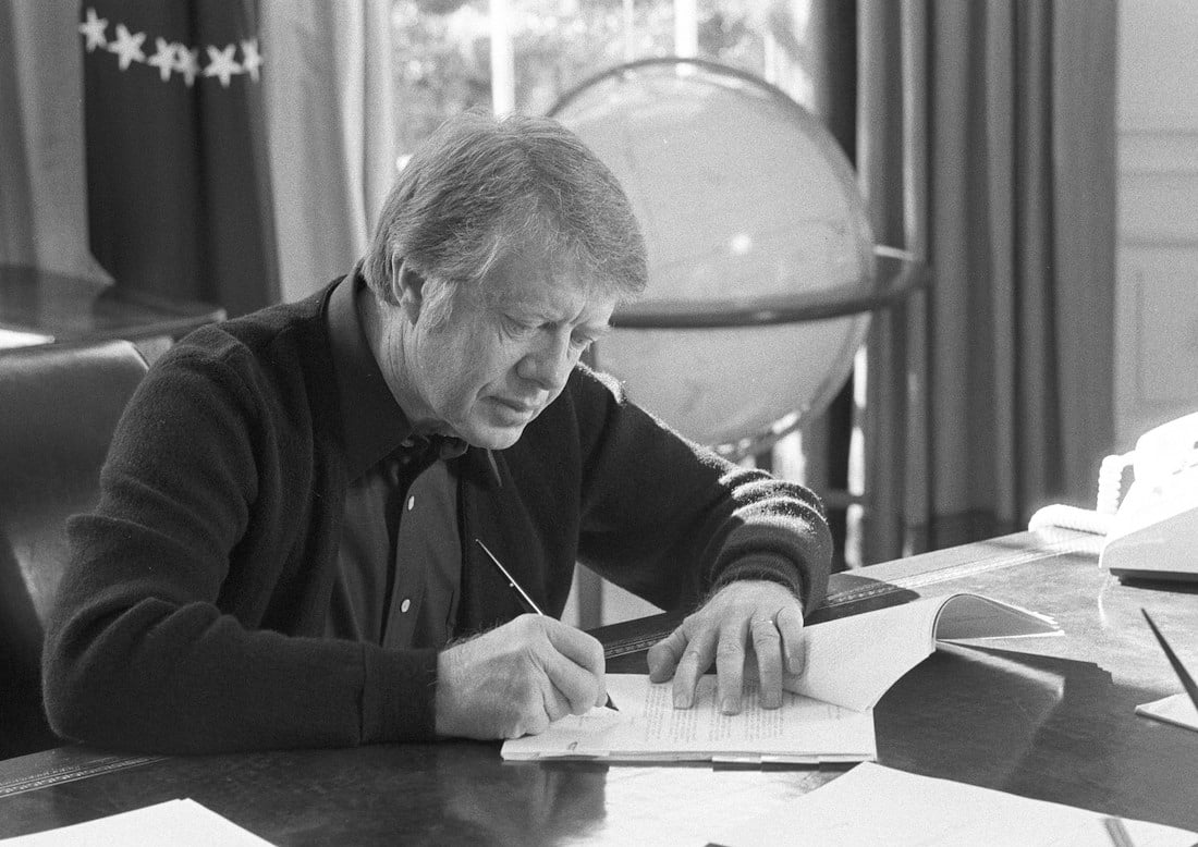 President Jimmy Carter at his desk in the Oval Office - courtesy Children's Bureau photostream via Flickr (CC BY SA, 2.0 License)