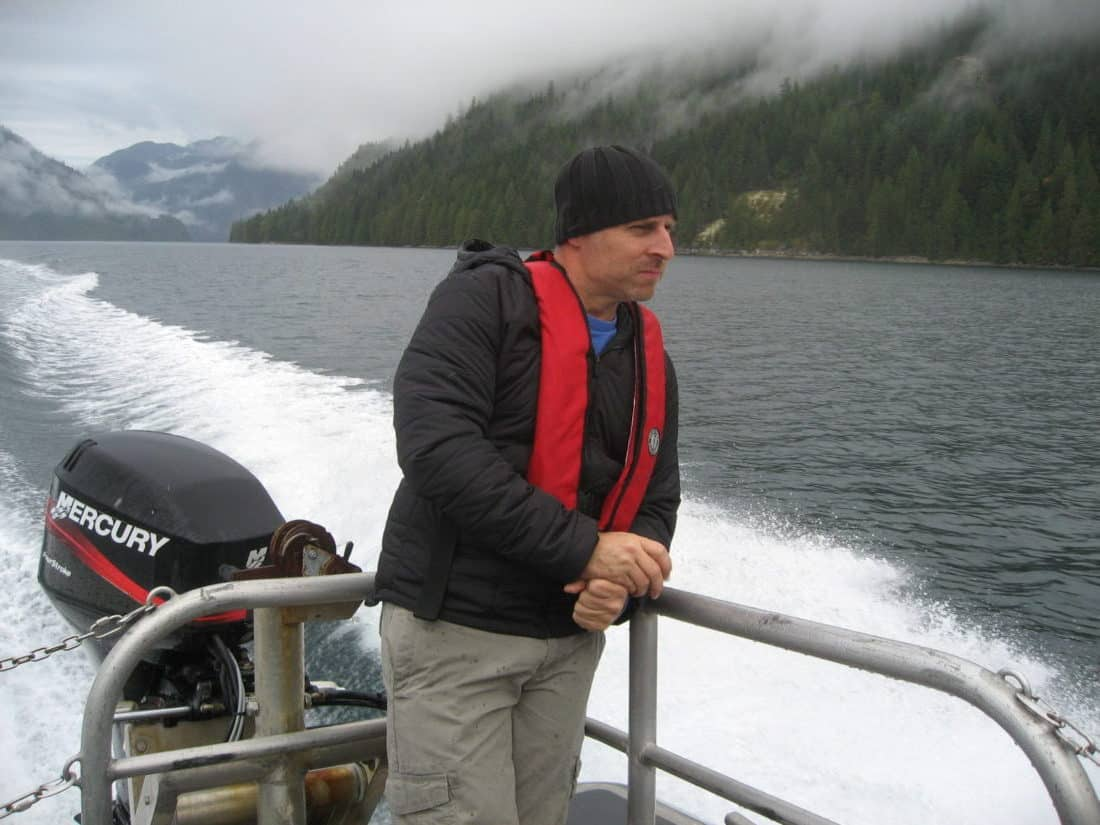 Ian Roberts on board the water taxi returning from Phillips Arm Fish Farm - Roy L Hales photo