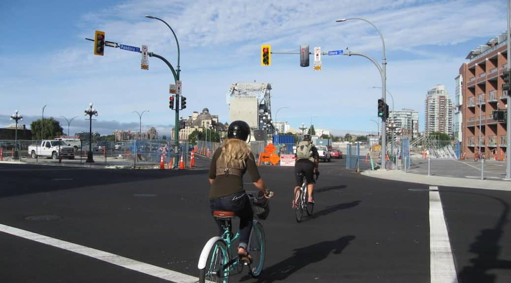 Cyclists heading towards Johnson Street Bridge, Victoria - Roy L Hales photo