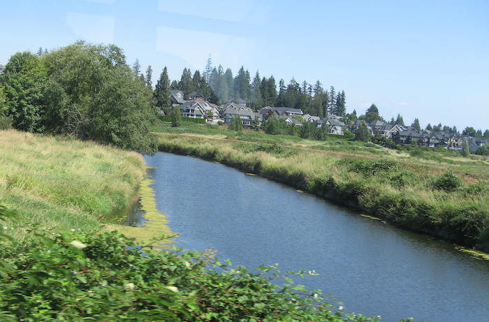 View of urban sprawl encroaching on the otherwise rural countryside seen from an Interurban window - Roy L Hales photo.