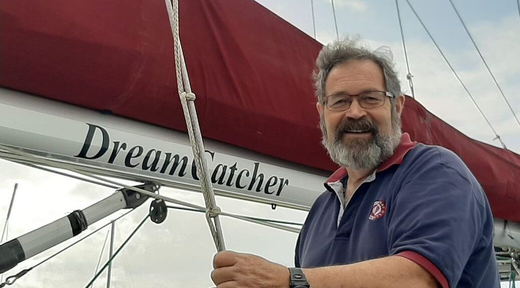 Norm Facey on his sailboat, Dreamcatcher
