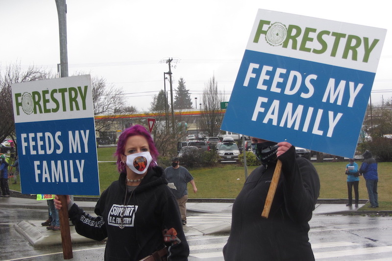 Two of the half dozen of so pro-industry demonstrators at ForestMarch 2021 in Courtenay