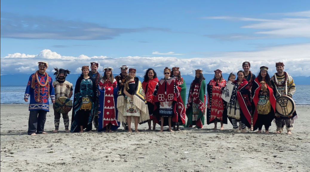 Kumugwe dancers at Kye Bay. Fifth from left, Lee Everson, followed by Hereditary Chief Nagedzi Rob Everson of the Giglagam Walas Kwaguł, and Keisha Everson.