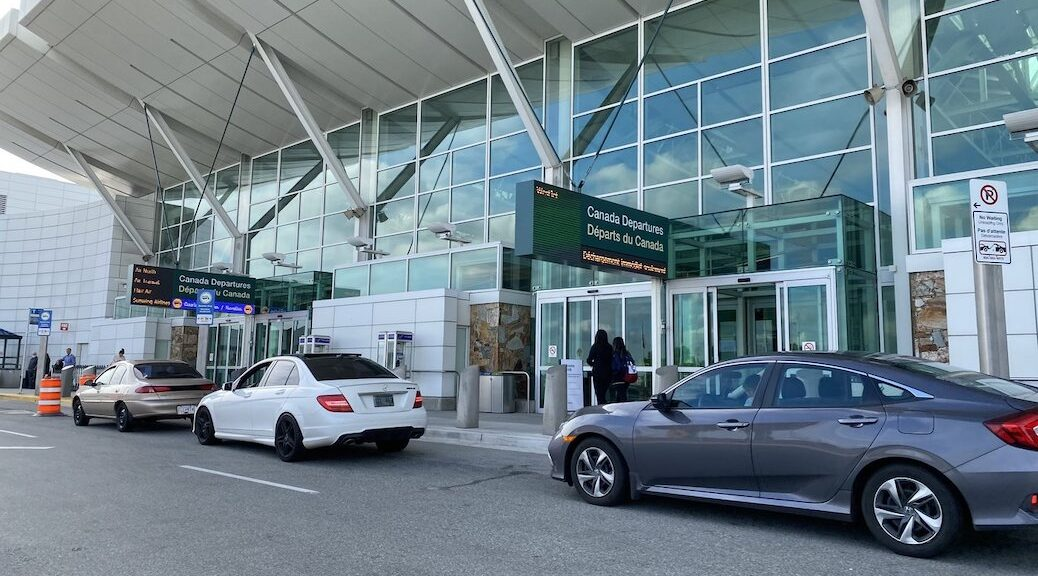Cars parked at the entrance of Vancouver International Airport