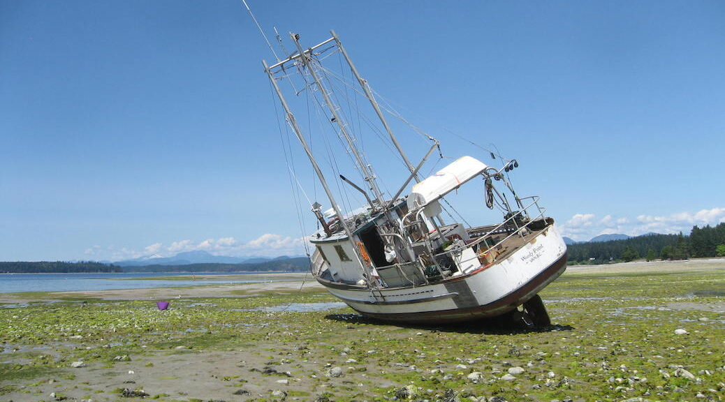 boat stranded by the tides on Cortes Island