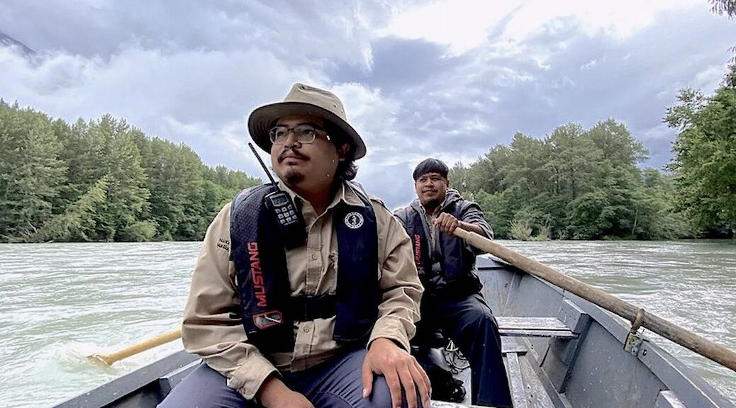 Two first nations men in a rowboat