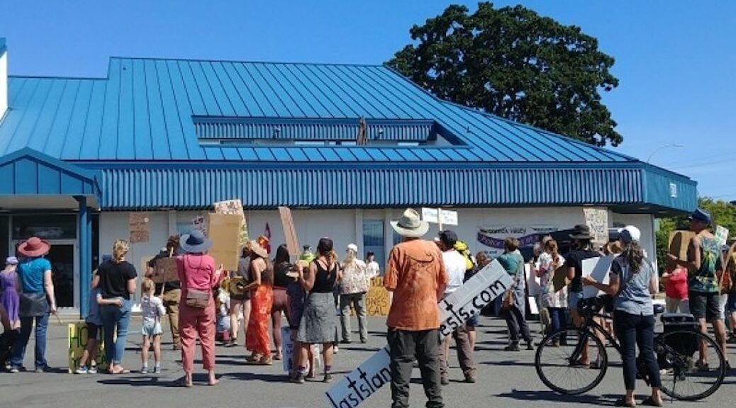 about 60 people in front of the RCMP detachment