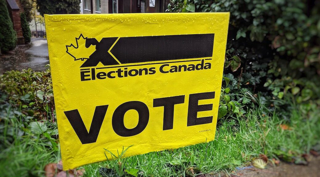 A yellow and black elections Canada poster urging people to vote