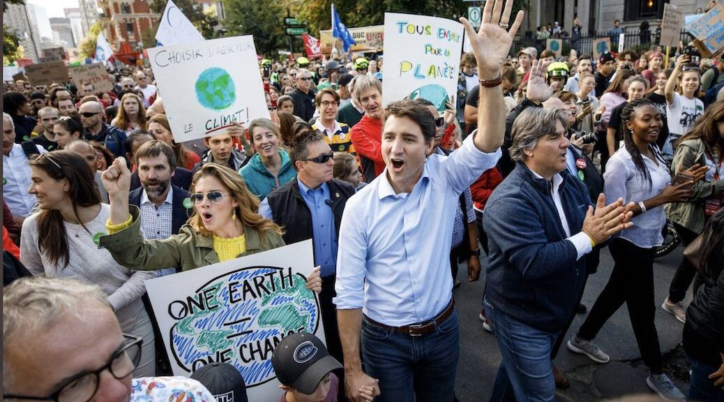 Justin Trudeau surrounded by cheering supporters