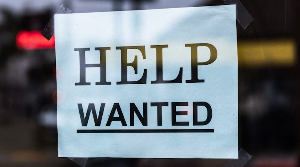 Help wanted sign in the window
